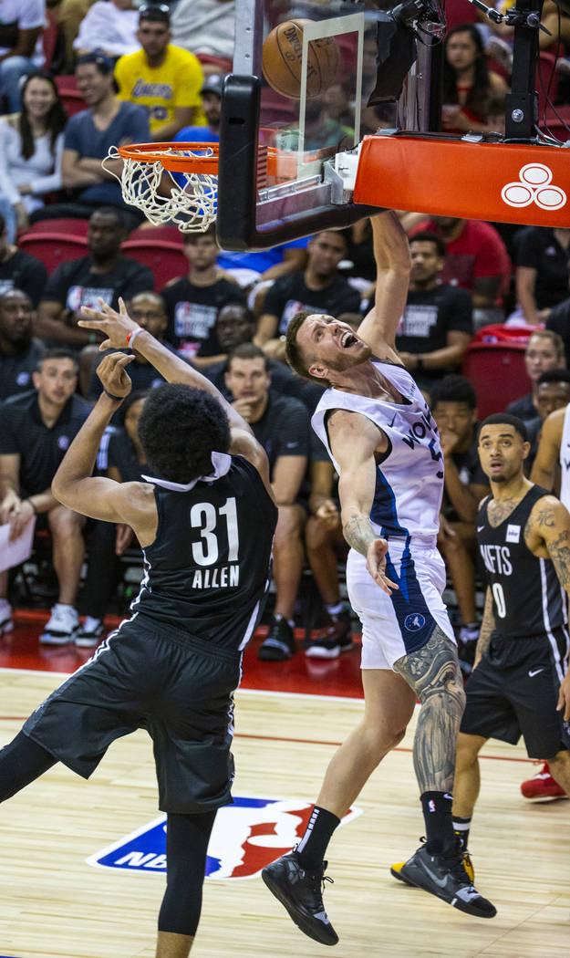 Brooklyn Nets center Jarrett Allen, left, is unable to defend a shot by Minnesota Timberwolves ...