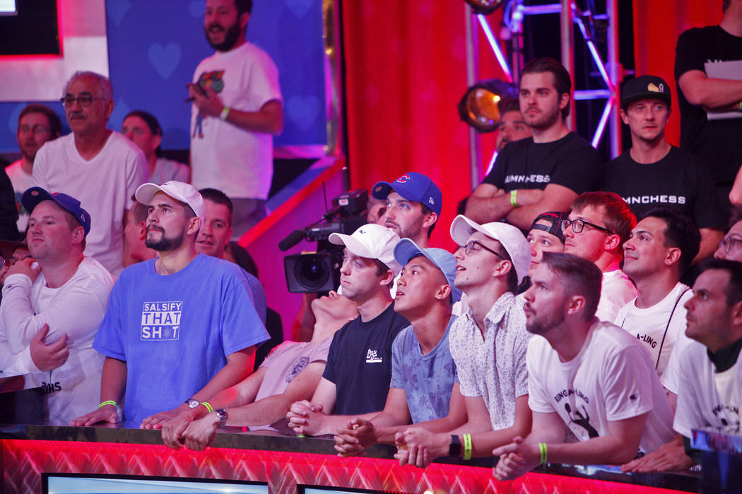 Fans watch the main event final table during the World Series of Poker at the Rio hotel-casino ...