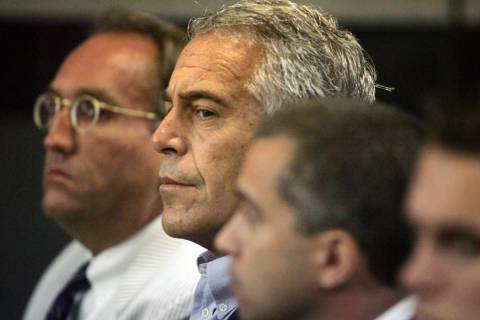 In a July 30, 2008, file photo, Jeffrey Epstein, center, appears in court in West Palm Beach, F ...
