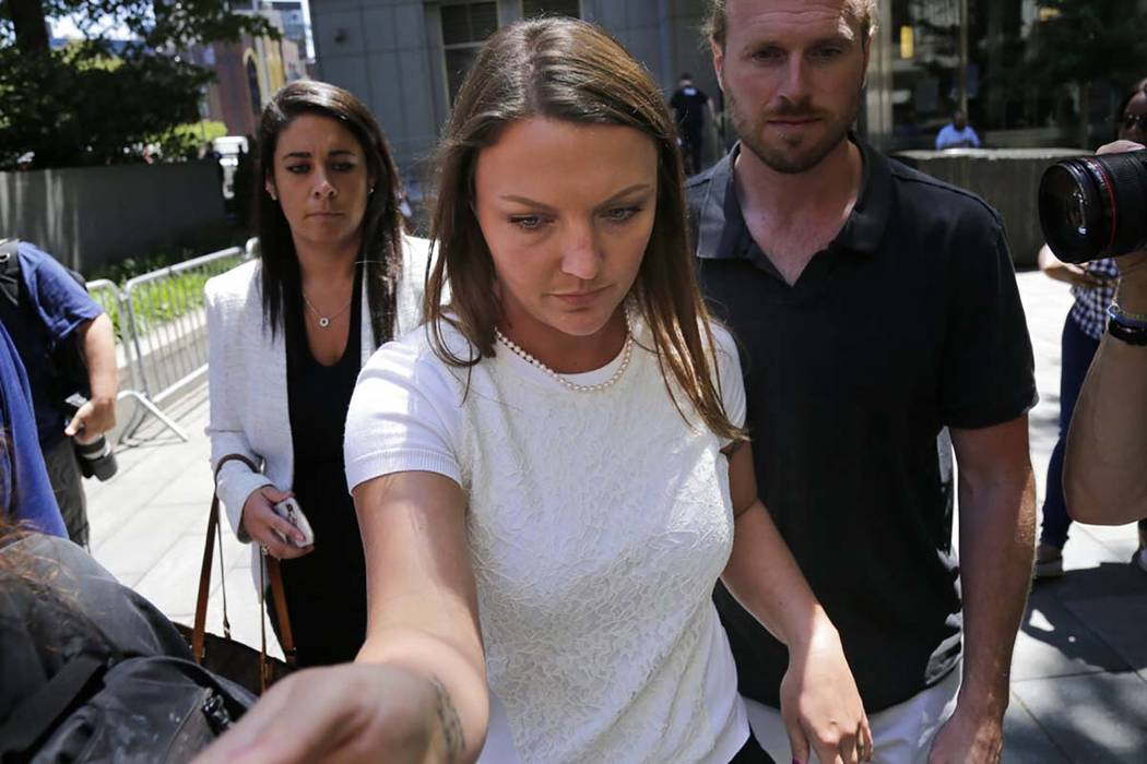 Courtney Wild, center, an accuser of Jeffery Epstein, leaves the courthouse in New York, Monday ...