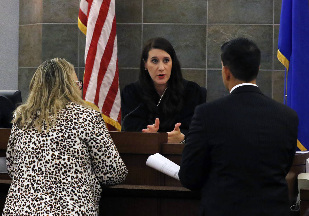 Justice of the Peace Harmony Letizia meets with Review-Journal attorney, Maggie McLetchie, left ...