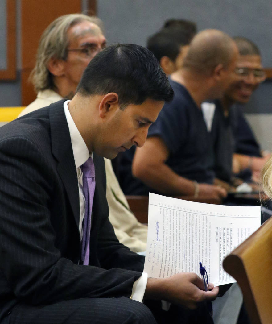 Jay P. Raman, chief deputy district attorney, reviews documents before a hearing at the Regiona ...