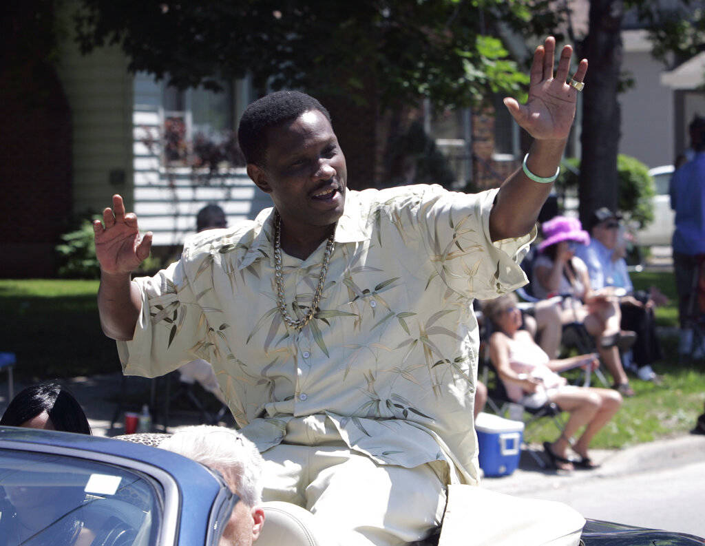 In a June 10, 2007, file photo, Pernell Whitaker waves to the crowd during a parade before he w ...