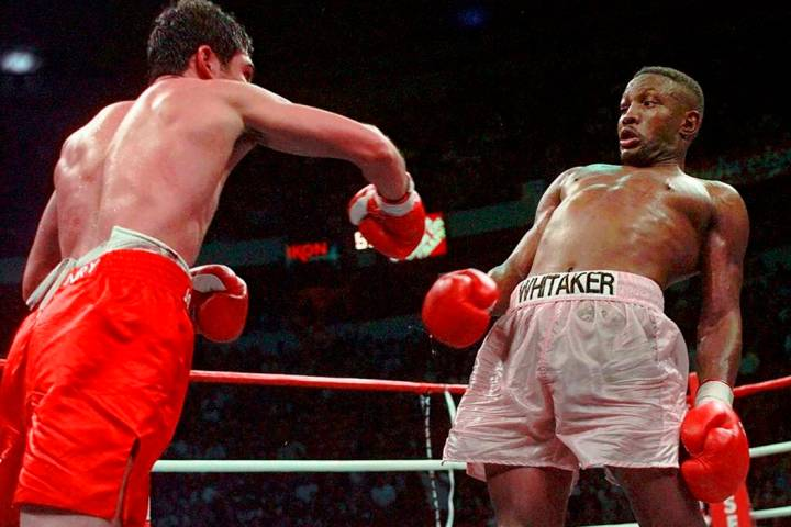 In an April 12, 1997, file photo, Pernell Whitaker, right, leans away from a punch by Oscar De ...