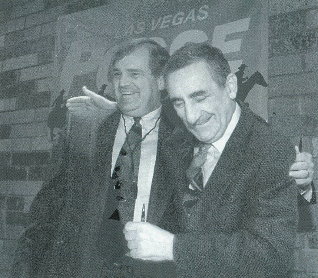 Las Vegas Posse head coach Ron Meyer, left, and owner Nick Mileti embrace during a news confere ...