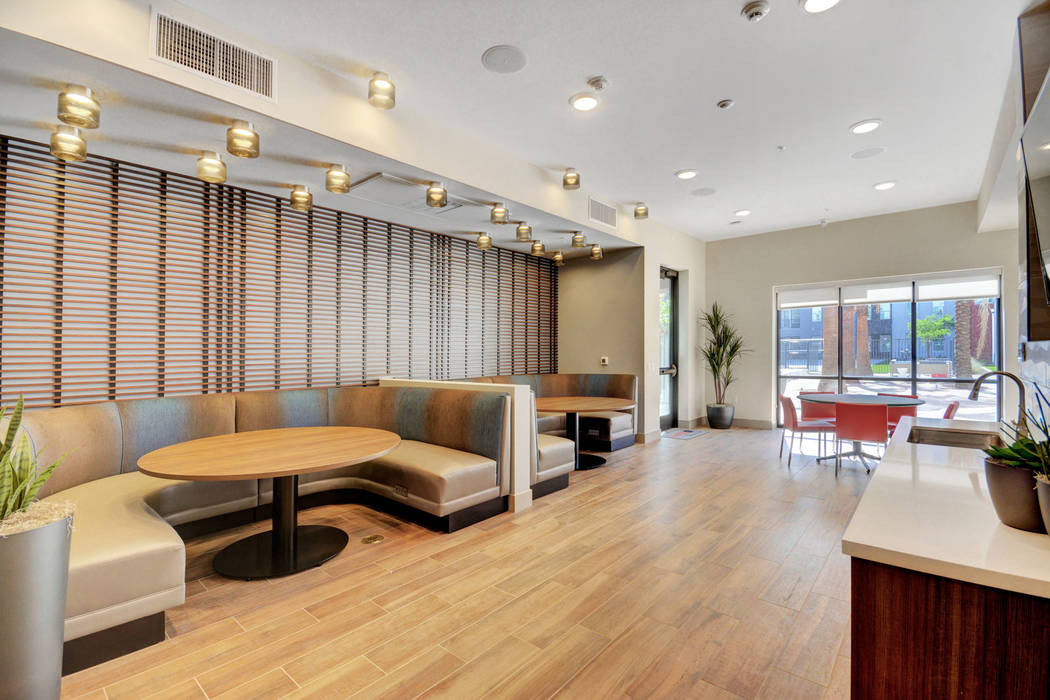 The Degree features a modern lobby with a lounge. (The Midby Cos.)