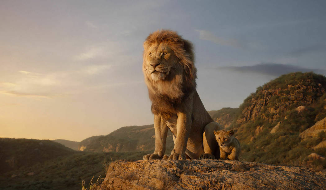 This image released by Disney shows characters, from left, Mufasa, voiced by James Earl Jones, ...