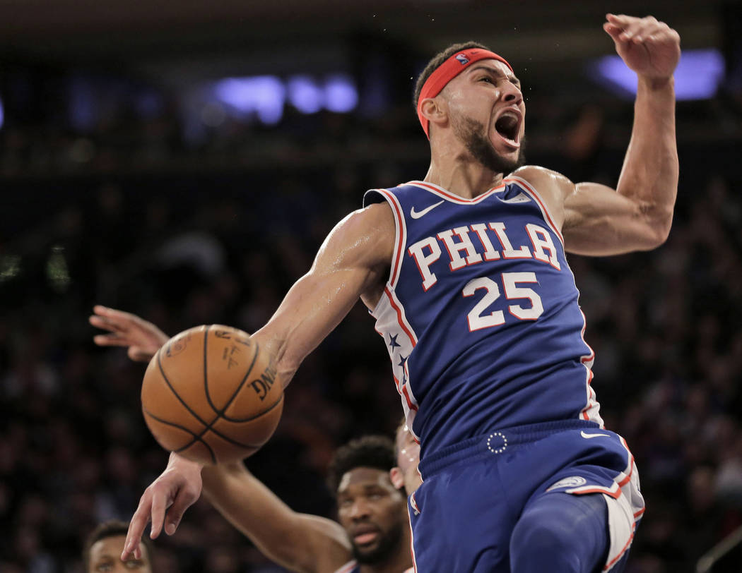 Philadelphia 76ers' Ben Simmons reacts after dunking during the first half of an NBA basketball ...