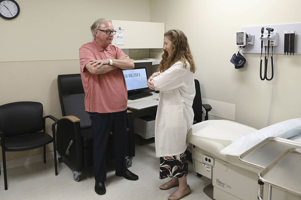 In this July 9, 2019 photo, Dr. Jori Fleisher, neurologist, examines Thomas Doyle, 66, at the R ...