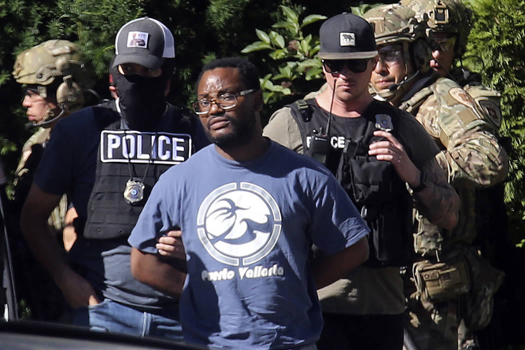 FILE - In this June 28, 2019, file photo, Salt Lake City police take Ayoola A. Ajayi into custo ...