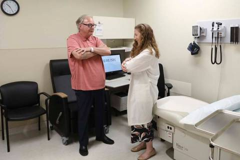 In a July 9, 2019 photo, Dr. Jori Fleisher, neurologist, examines Thomas Doyle, 66, at the Rush ...