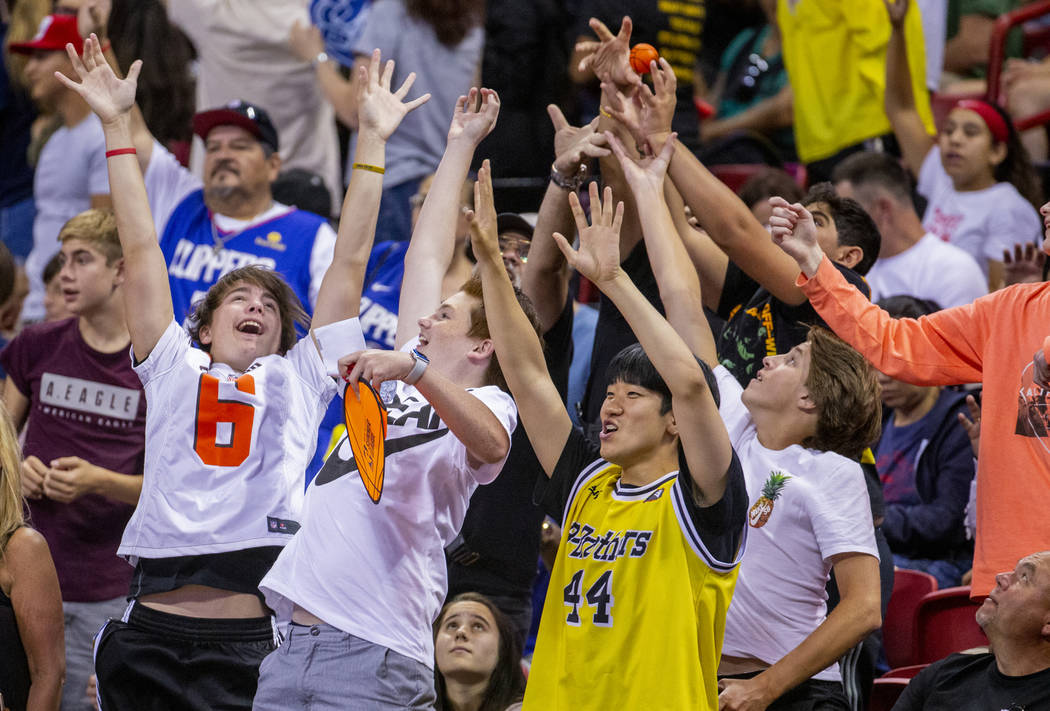 Fans get excited about catching a little basketball as the Memphis Grizzlies face the Minnesota ...