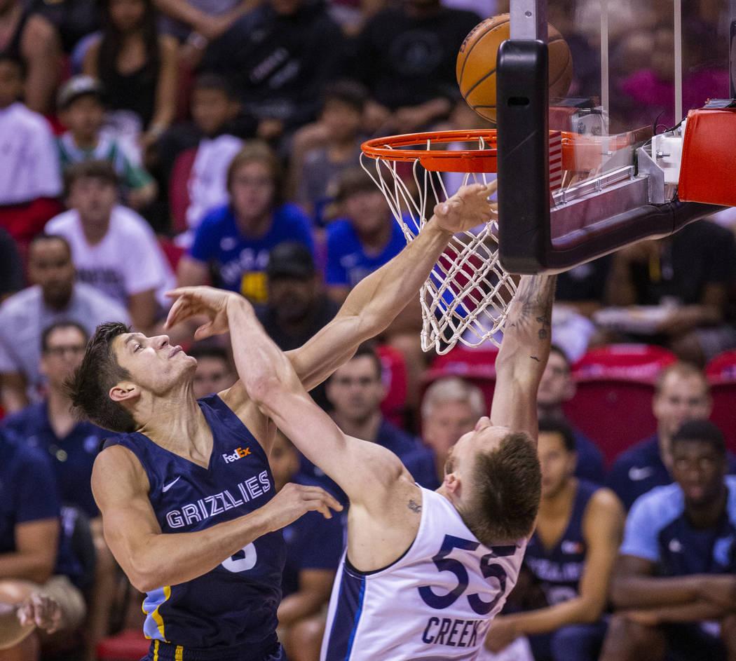 Memphis Grizzlies guard Grayson Allen, left, battles for the basket with Minnesota Timberwolves ...
