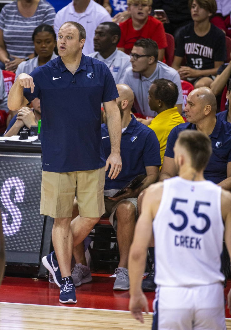 Memphis Grizzlies head coach Taylor Jenkins calls in another play versus the Minnesota Timberwo ...