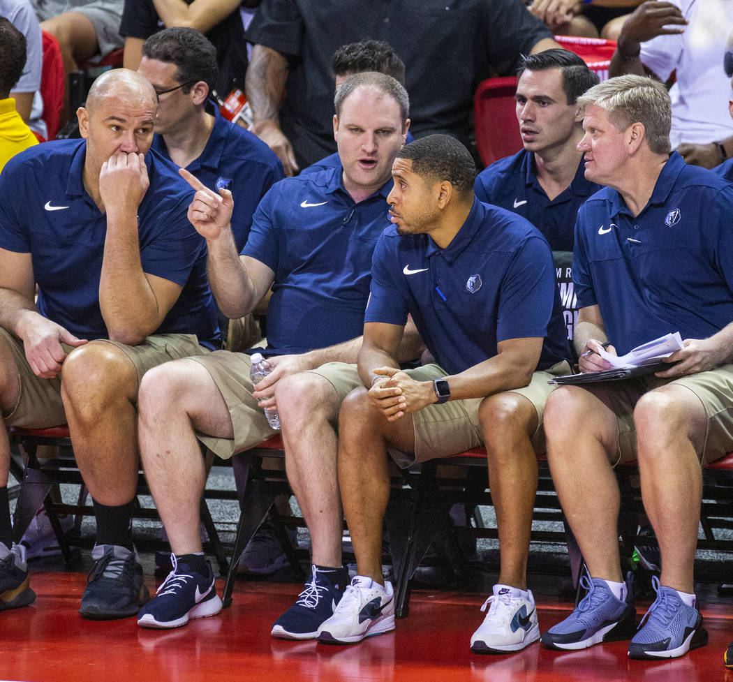 Memphis Grizzlies head coach Taylor Jenkins confers with his other coaches versus the Minnesota ...