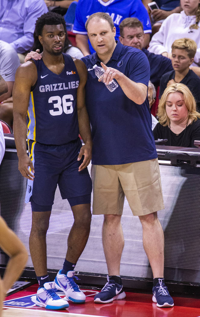 Memphis Grizzlies guard Keenan Evans, left, gets a few tips from his head coach Taylor Jenkins ...