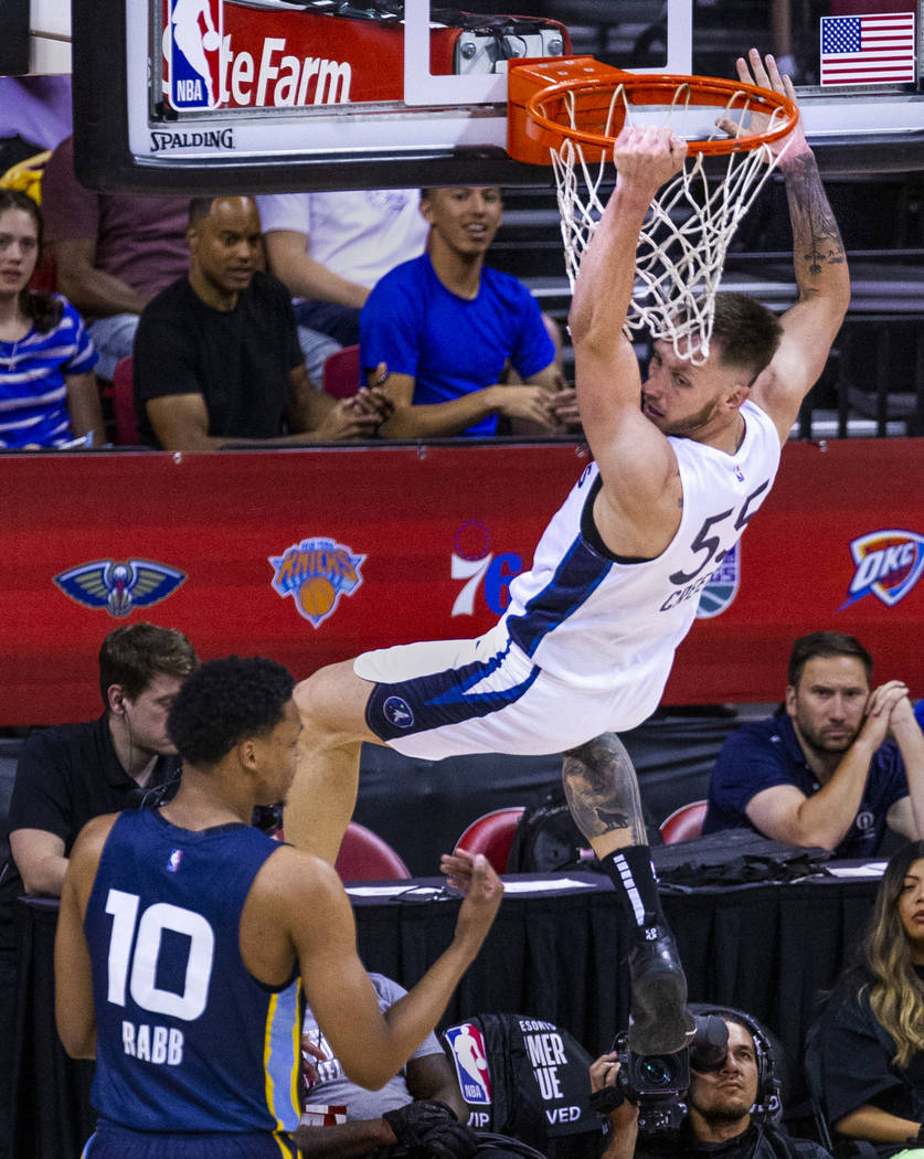 Minnesota Timberwolves forward Mitch Creek, above, looks back after a big dunk over Memphis Gri ...