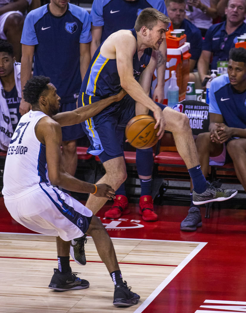 Minnesota Timberwolves forward Keita Bates-Diop, left, reaches in for a possible take away from ...