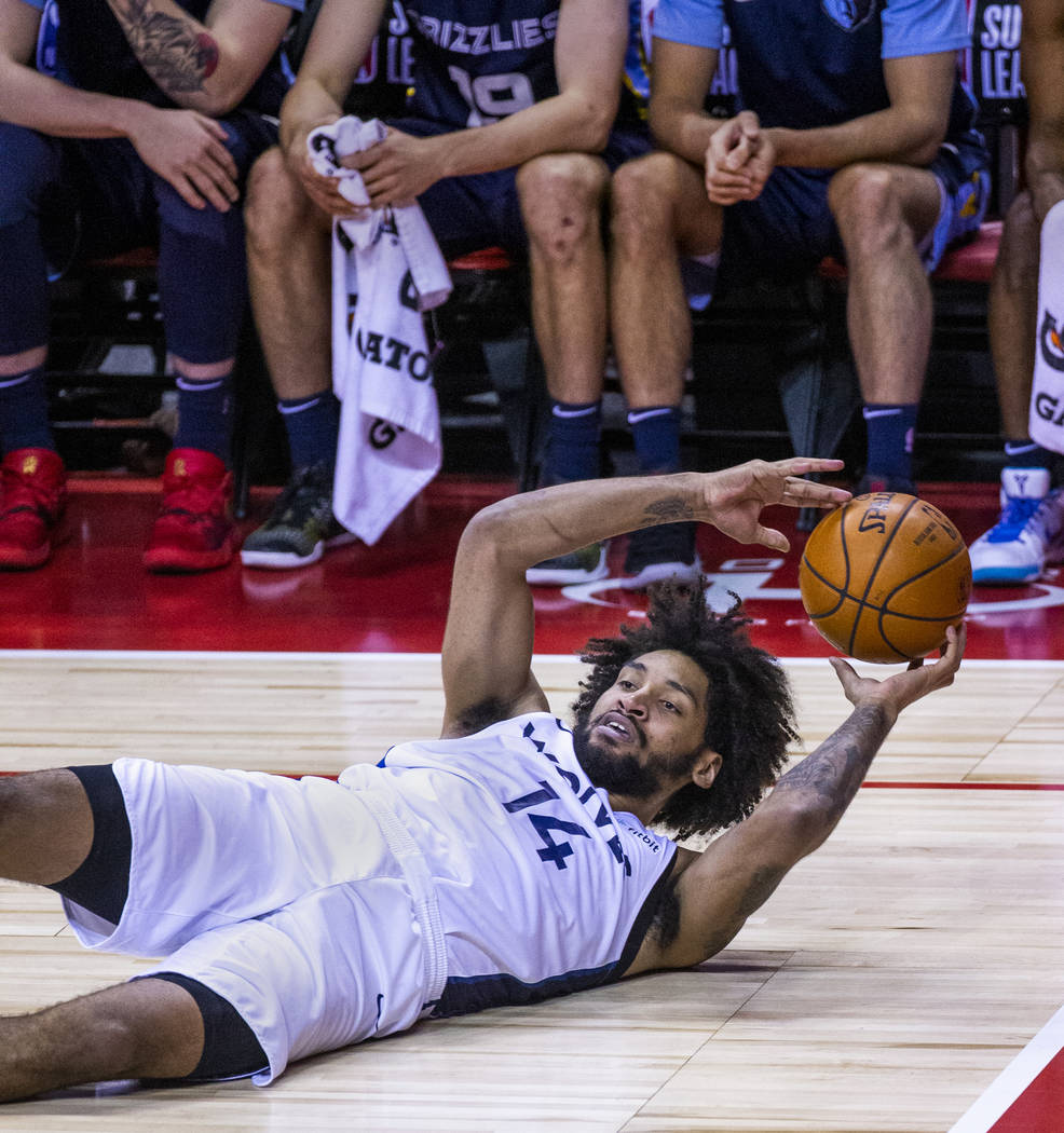 Minnesota Timberwolves forward Jordan Murphy looks to pass from down on the court versus the Me ...