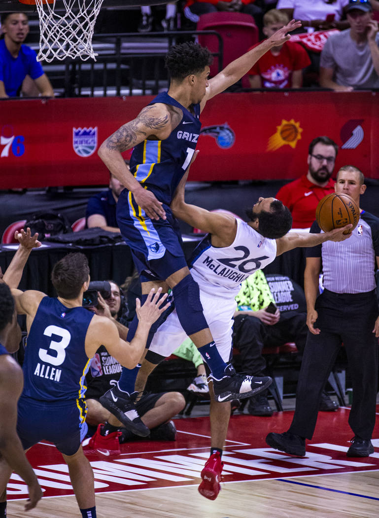 Memphis Grizzlies forward Brandon Clarke, above, gets up high to defend a shot from Minnesota T ...