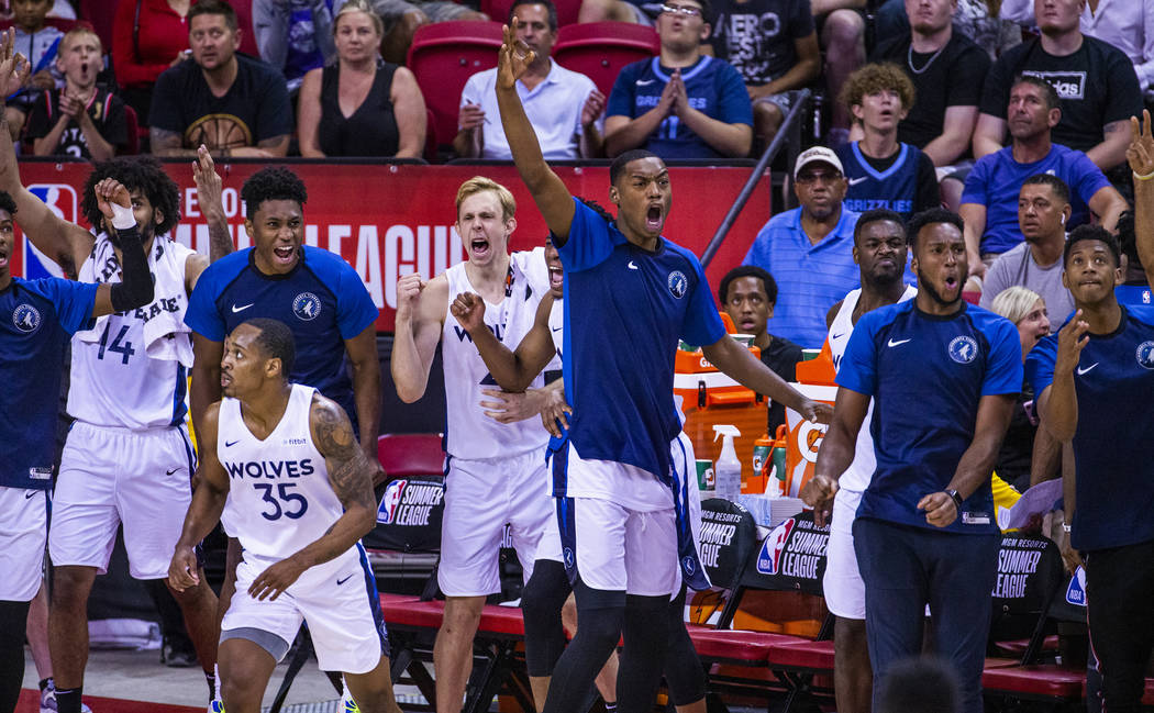 Minnesota Timberwolves' players cheer on their teammates as the close the gap versus the Memphi ...