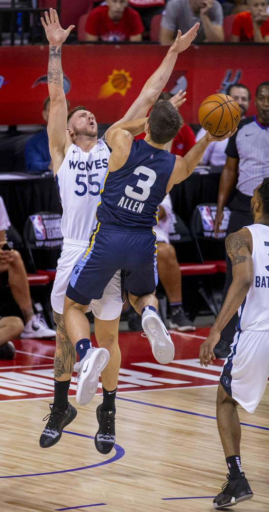 Minnesota Timberwolves forward Mitch Creek, left, defends the basket as Memphis Grizzlies guard ...