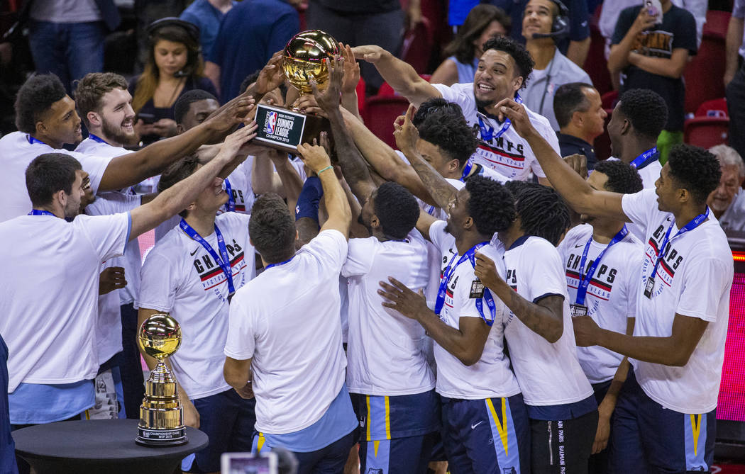 Memphis Grizzlies' players hoist and touch the winning trophy after defeating the Minnesota Tim ...