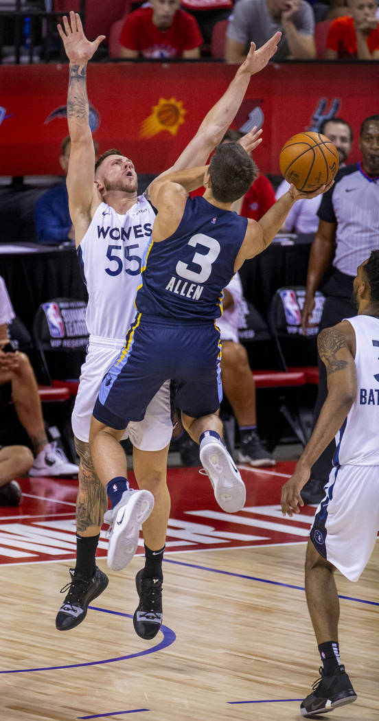 Minnesota Timberwolves forward Mitch Creek, left, defends the basket as Memphis Grizzlies guard ...