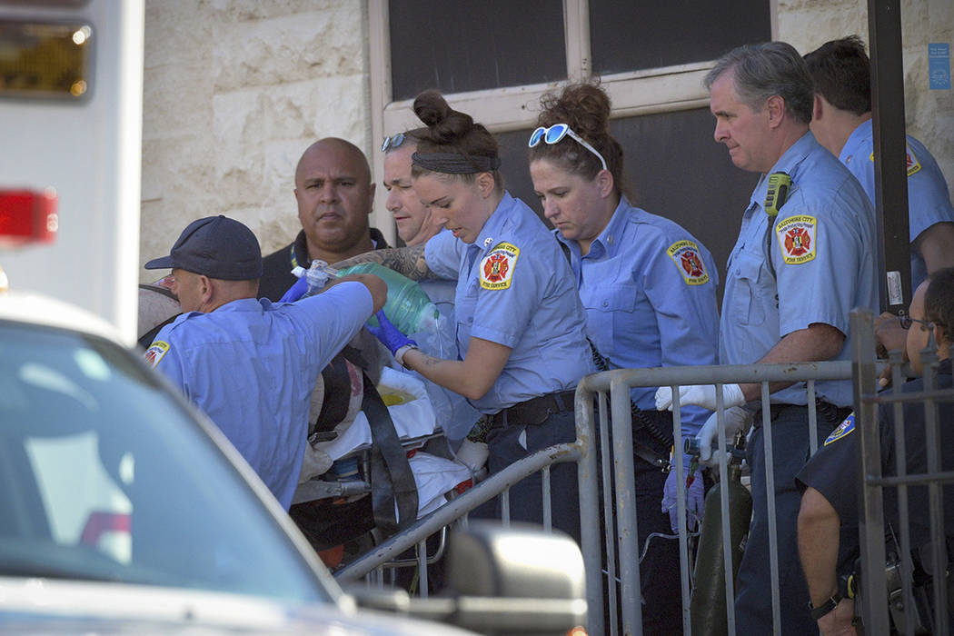 Baltimore Fire Dept. paramedics transport a patient from the Man Alive drug treatment center on ...