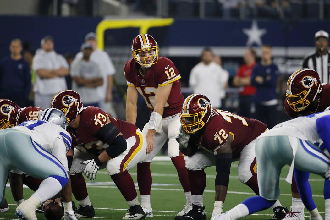 Washington Redskins quarterback Colt McCoy (12) prepares for the snap along with guard Jonathan ...