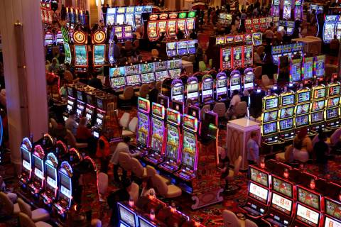 Some of the first guests gamble on the casino floor during the opening of the $2.6 billion Enco ...