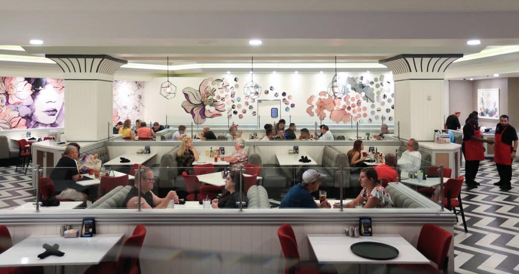 Diners enjoy a meal at the Strat Cafe, a new eatery opened as part of renovations to the Strat ...