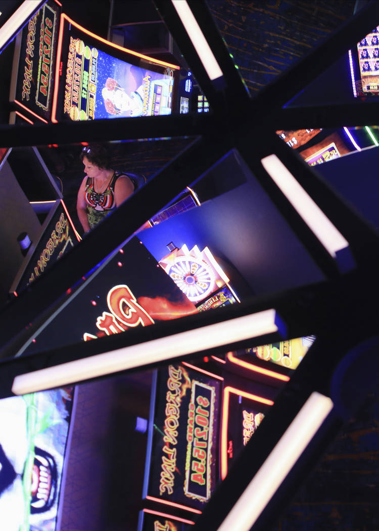 Slot machines are reflected in the ceiling of the Link Slot Lounge, a new gaming area at the St ...
