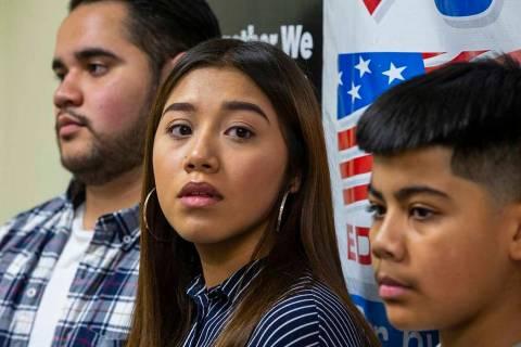 Omar Arellano Cruz, 21, left, Kimberly Arellano Cruz, 16, and AJ Arellano Cruz, 12, listen in a ...