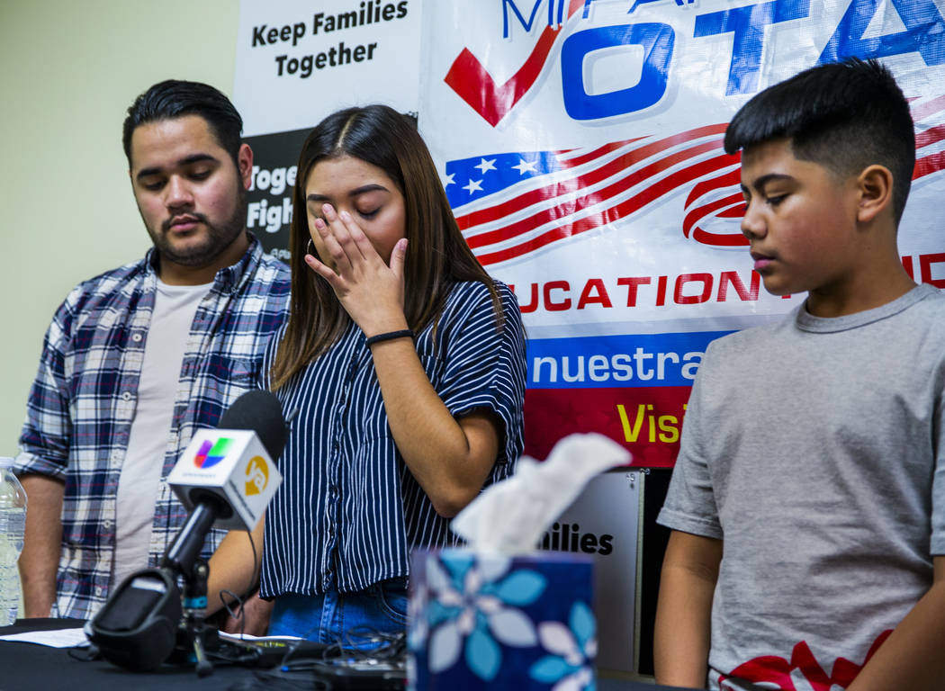 Kimberly Arellano Cruz, 16, center, becomes emotional beside her brothers Omar Arellano Cruz, 2 ...
