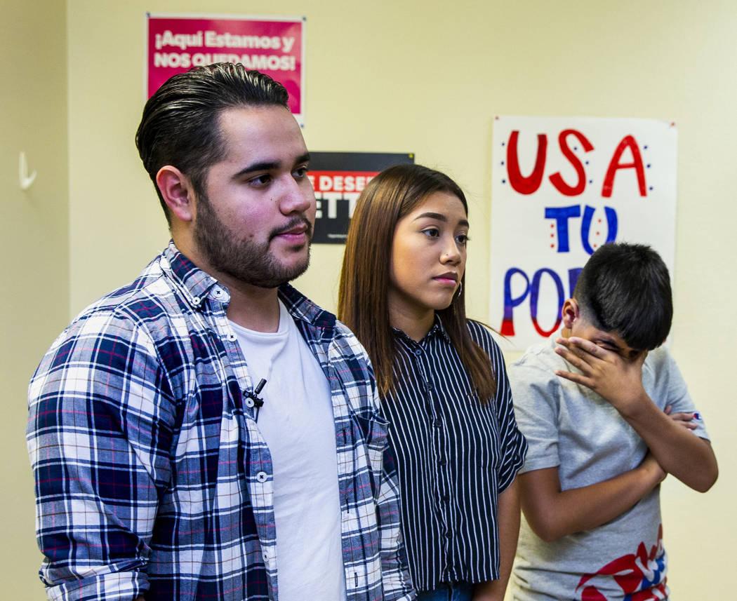 Omar Arellano Cruz, 21, left, Kimberly Arellano Cruz, 16, and AJ Arellano Cruz,12, listen to a ...