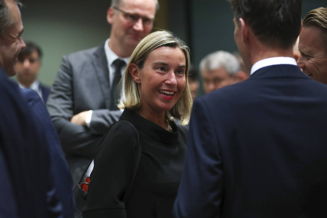 European Union foreign policy chief Federica Mogherini, center, arrives for a European Foreign ...