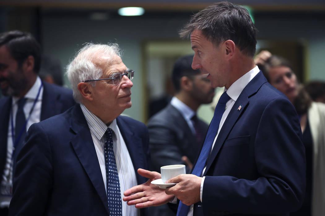 Britain's Foreign Secretary Jeremy Hunt, right, talks to his Spanish counterpart Josep Borrell ...