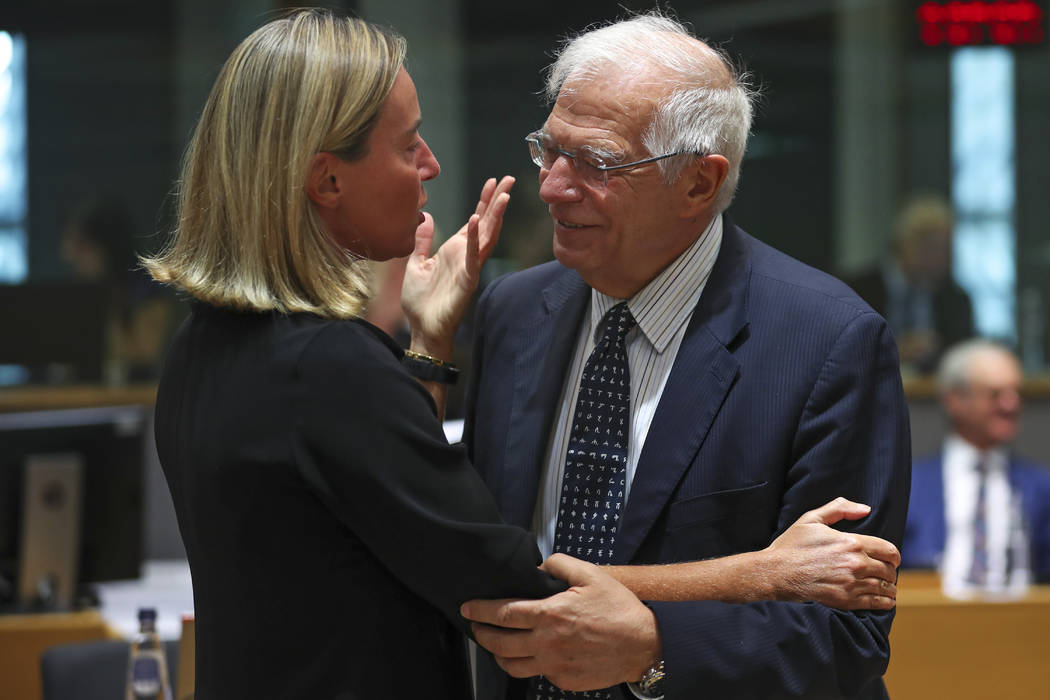 European Union foreign policy chief Federica Mogherini, left, talks to Spain's Foreign Minister ...