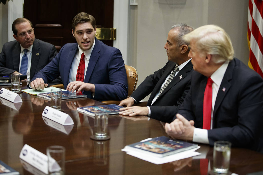 JT Lewis, brother of Sandy Hook victim Jesse Lewis, speaks to President Donald Trump during a r ...