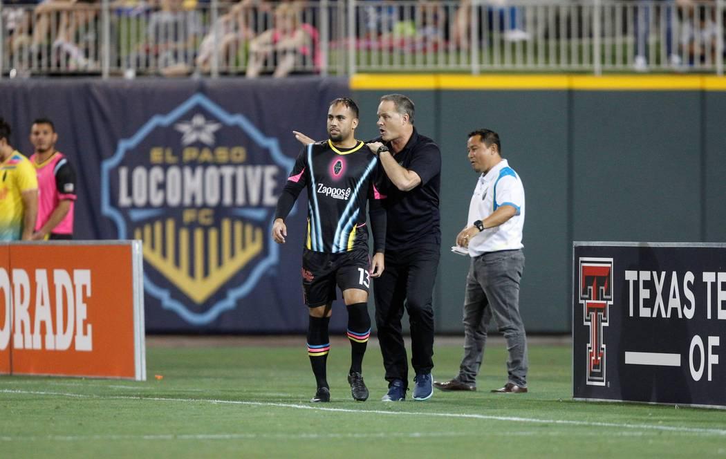 Jesus Gonzalez gets instructions from Lights FC coach Eric Wynalda prior to making his USL Cham ...