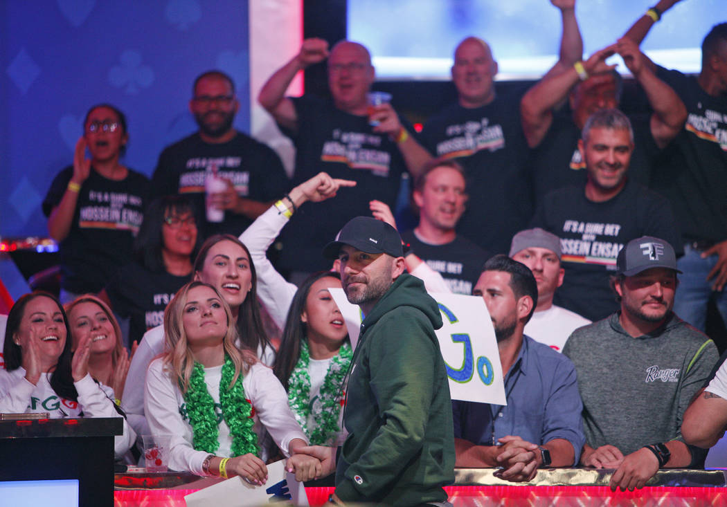 Gary Gates greets his friends and family during a break on the second day of the main event fin ...