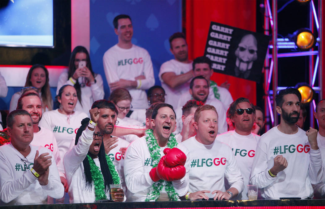 Fans of Garry Gates cheer him on at the main event final table at the World Series of Poker tou ...