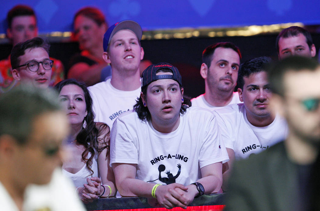Fans of Kevin Maahs watch the main event final table at the World Series of Poker tournament at ...
