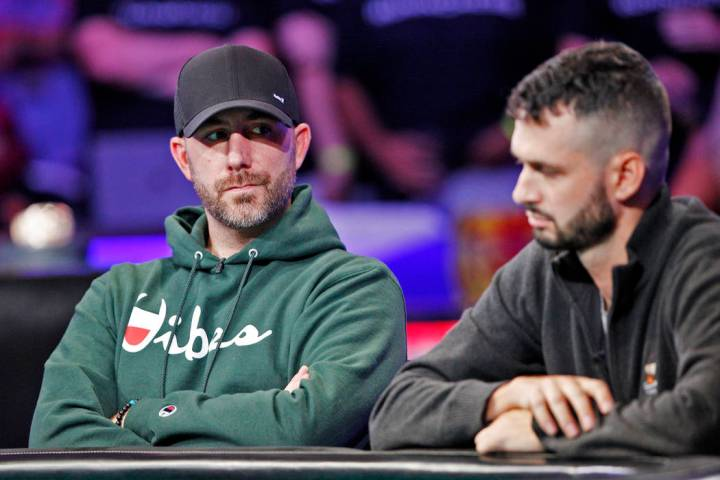 Garry Gates, left, and Alex Livingston, right, on the second day of the main event final table ...