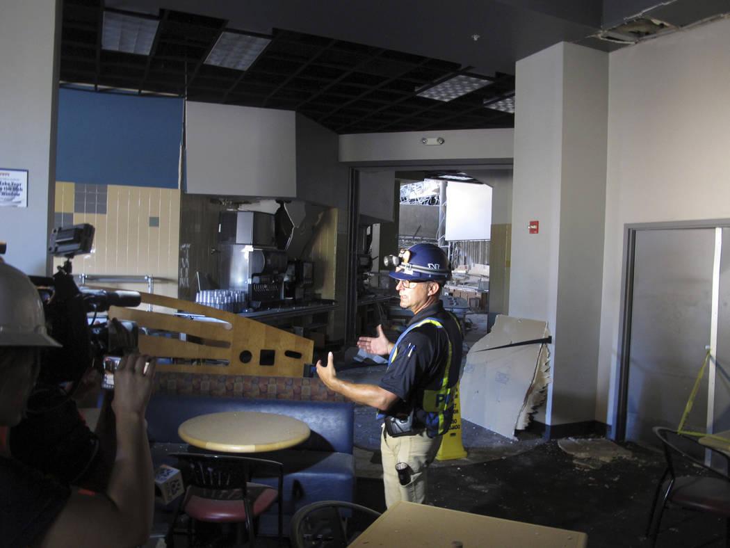 University of Nevada, Reno Police Chief Todd Renwick describes the damage inside a school dormi ...