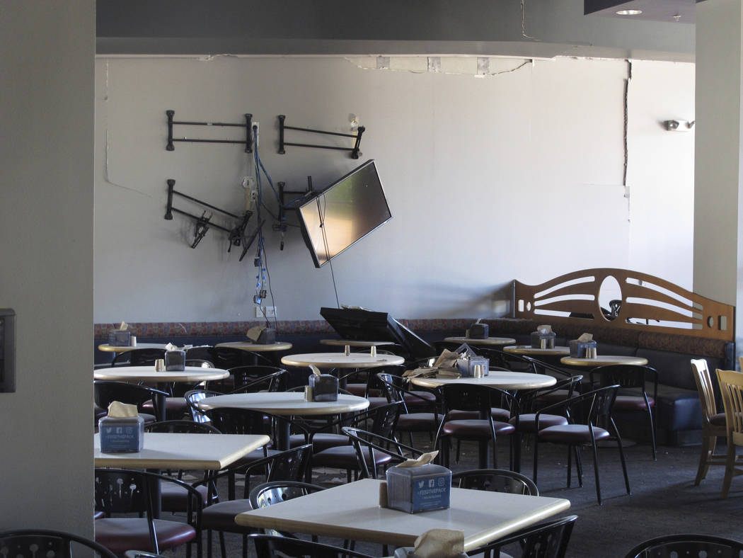 Damage is seen in the first-floor cafeteria at a University of Nevada, Reno dormitory, Thursday ...