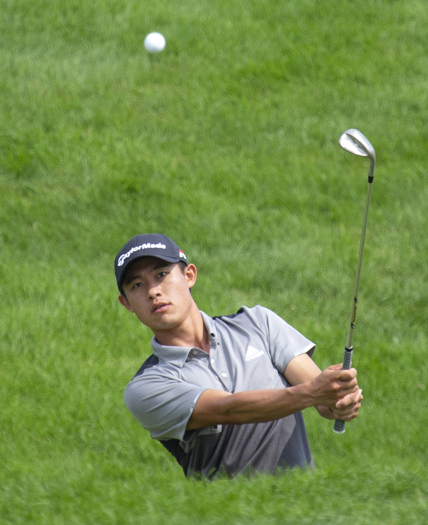 Collin Morikawa hits from the rough on the 12th hole during the final round of the 3M Open golf ...