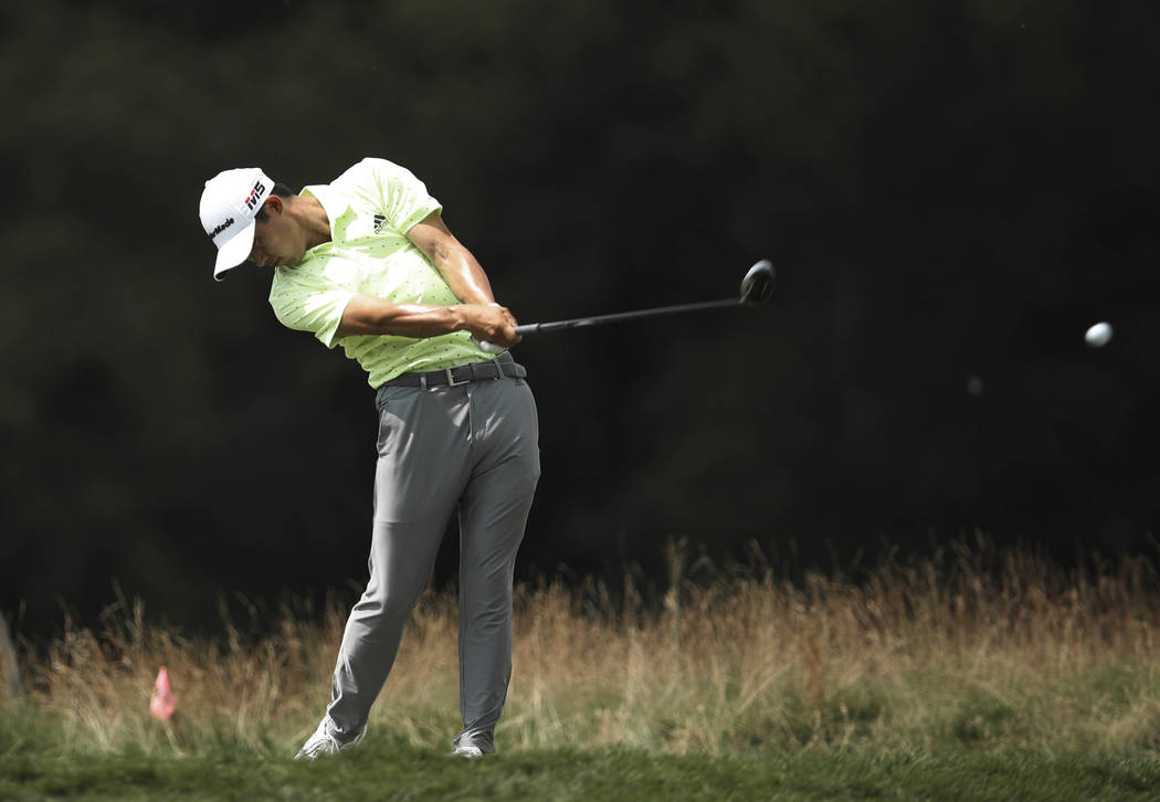 Collin Morikawa hits a tee shot at 14 during the third round of the 3M Open golf tournament in ...