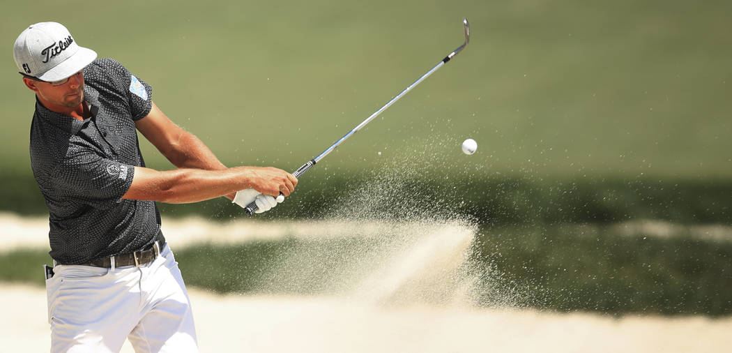 Collin Morikawa hits out bunker at seven during the third round of the 3M Open golf tournament ...